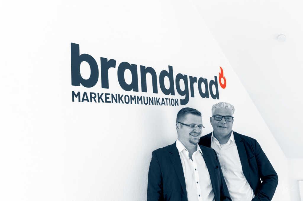 André und Ich unter unserem Brandgrad Logo |Johannes Ulrich Gehrke